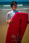 participant with boogie board at beach